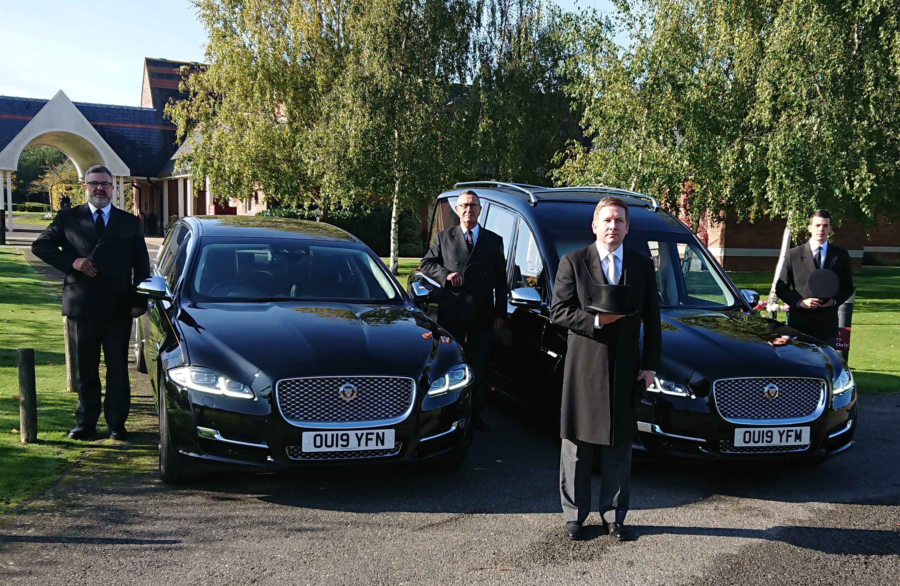 Bournes Funeral team standing in front of a vehicle